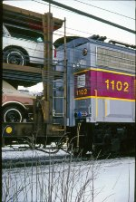 MBTA 1102 on its way from the rebuilder to Boston. Photo taken on Broadway next to Frontier Yard. February 1979 photo