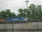 "BNSF ""Smurf"" hides behind the fence"