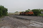 BNSF 8045 Leads a rack train west into pouring rain.