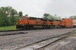 BNSF 8279 Rocks a stack out of the rain.