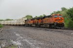 BNSF 7597 Leads a Q train out of the Monsoon.