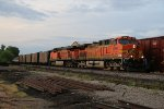 BNSF 5699 Notches up on a coal load.