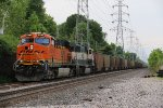 BNSF 6309 Waits to meet a empty coal in the hole.