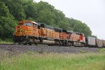BNSF 8824 Sits and waits to meet a empty coal in the rain.