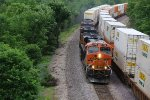 BNSF 7152 Meets a Westbound Q train on the Hill.