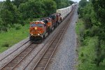 BNSF 7054 Eases down hill out of Wyaconda Mo.