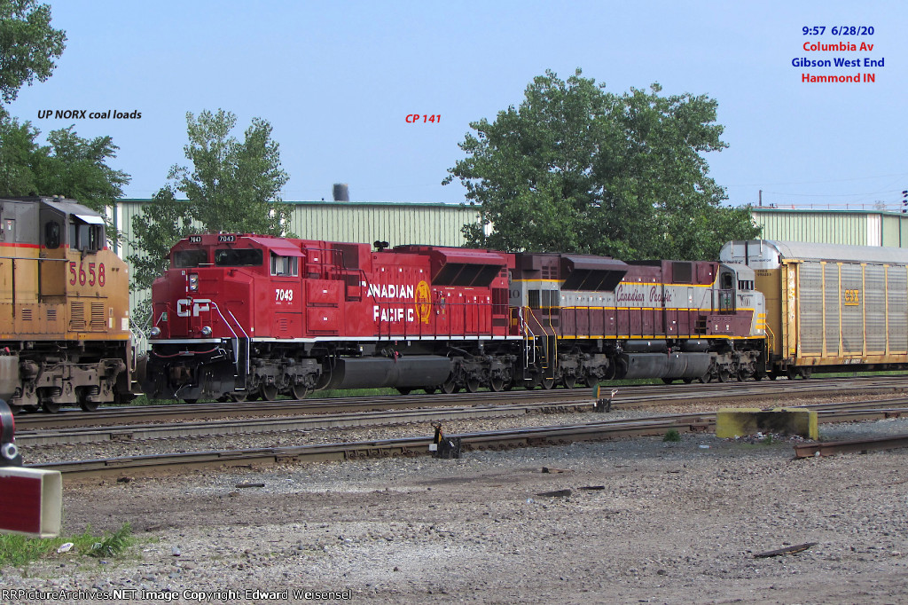 A pair of SD70ACUs just about to disappear behind the coal loads @ Gibson West End
