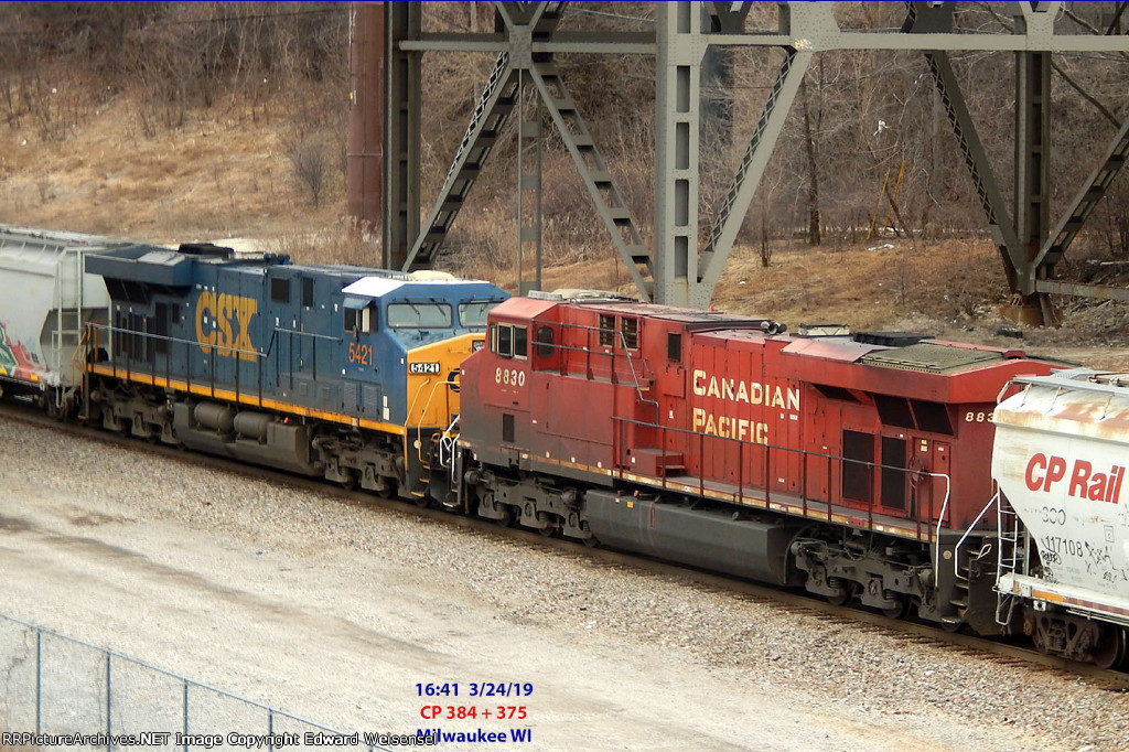 Mid-train dpus in CP 384 & 375 rolls into Muskego yard