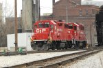 Two orange vests ride the Canadian Gp38-2 schnoz