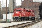 Two orange vests ride the Canadian Gp38-2 schnoz