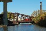 Pulling a cut across Burnham bridge beneath shadows of I-43/94