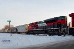 CP 581 with fresh beaver 8059, this south-of-the-border ACe #2, grain empties trailed by oil empties