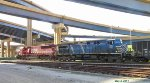 SOO 6044 and the bluebird roll coke empties beneath the Marquette interchange