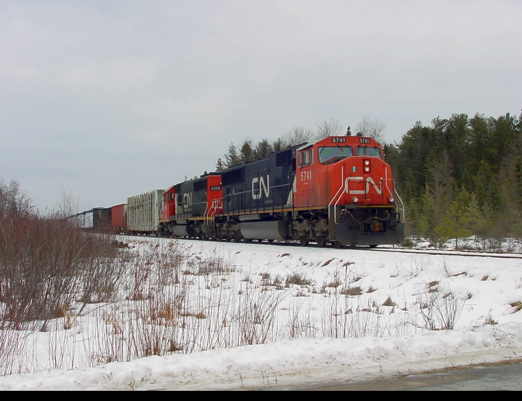 CN 5741 waits for the Tomahawk Railway to arrive at Jersey City, WI