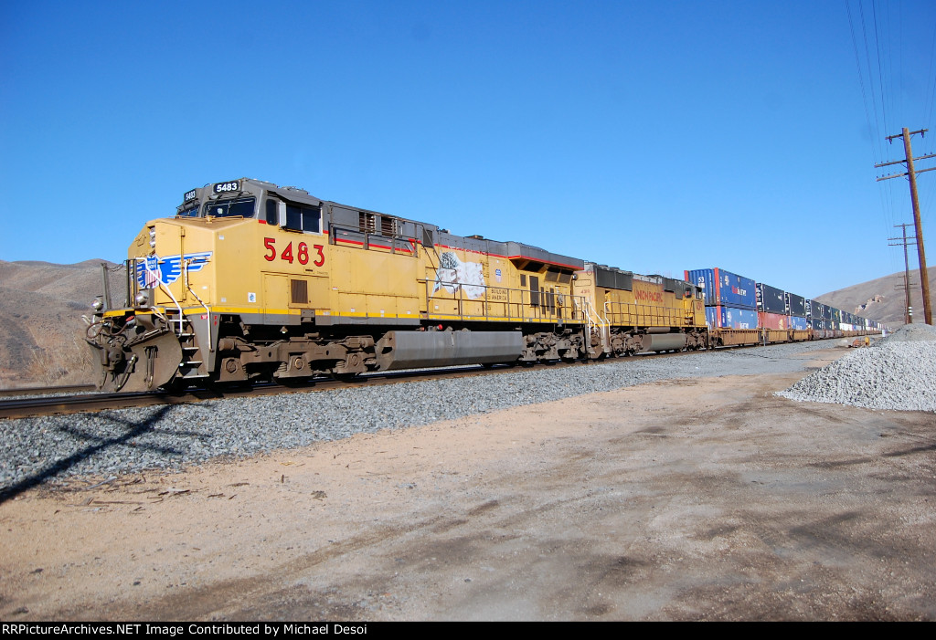 UP C45ACCTE #5483 leads an eastbound stack train at Echo, UT. March 10, 2015