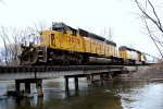 """UP SD-40-2 #3035 (ex CNW, nose gong INTACT) """"We Will Deliver"""" leads the northbound Cache Valley Local across the Logan River in Logan, UT. 3/17/2015"""