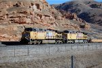 UP AC4400CWCTE #5595 leads a westbound baretable at the I-80/84 westbound on ramp in Echo, UT. March10, 2015