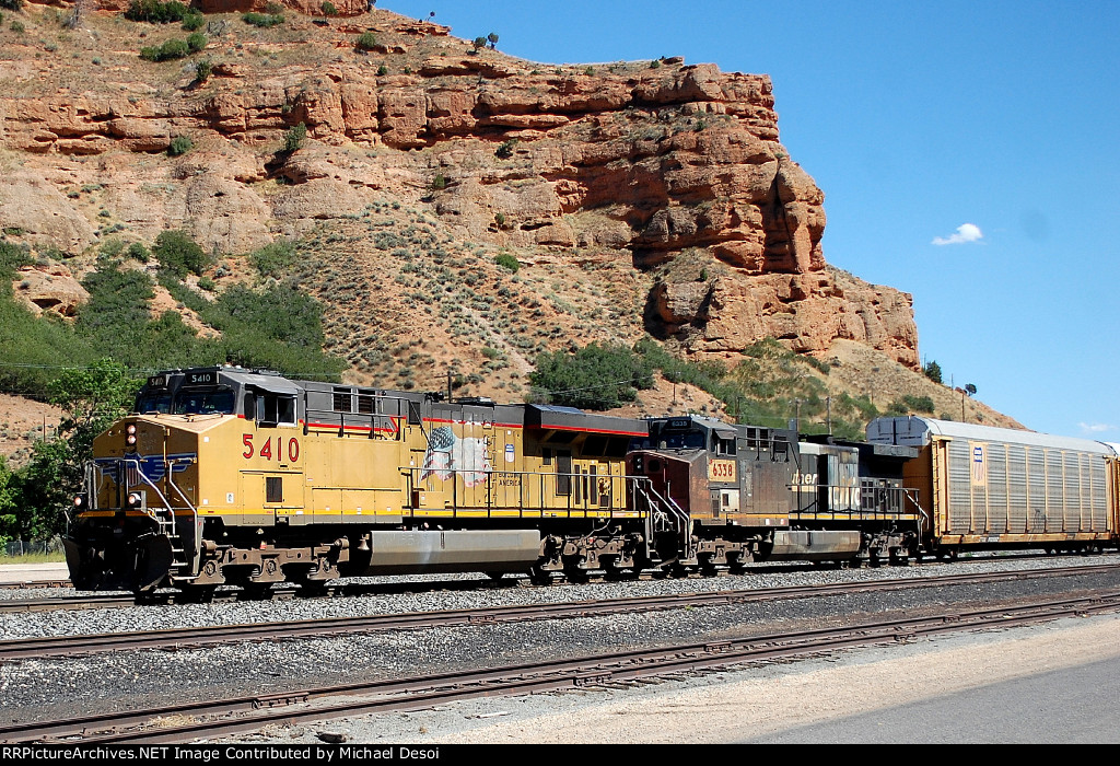 UP C45ACCTE #5410 leads an ex SP AC-4400CW on a westbound train at Echo, NY. 8/16/2014