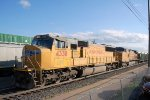 UP SD-70M #4338 leads an eastbound ballast train into the busy yard at Cheyenne, WY. 6/12/2014