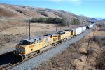 UP ES-44AC #7688 leads a westbound about to go under the Echo Canyon Rd. OHB in Henefer, UT. 11/26/2014