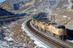 UP ES-44AC #7737 leads an eastbound stack train about to go under the Echo Canyon OHB in Emory, UT. 11/26/2014
