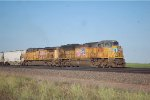 UP SD-70ACE #8426 leads a westbound grain train just west of the I-80, next to The Lincoln Highway in Cheyenne, WY. 6/12/2014