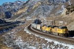 UP SD-70ACE #8813 leads an eastbound grain train about to go under the Echo Canyon OHB in Emory, UT. 11/26/2014