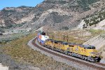 UP C-45AH #8144 leads an eastbound stack train (ZCIG1) at the Echo Canyon Rd. OHB, just east of Emory, UT. 8/16/2014