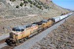 UP AC-4400CW #6872 leads a westbound grain train at the Echo Canyon Rd. OHB in Emory, UT. 9/20/2014