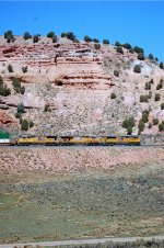 """UP SD-70AH #8845 pulls an eastbound stack train under """"The Rock"""" at Castle Rock, UT. 9/20/2014"""