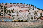 """UP SD-70ACE #8474 & SD-70M #4619 lead a westbound autorack train under """"The Rock"""" at Castle Rock, UT. 9/20/2014"""