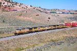 UP AC-4400CW #7230 leads a westbound stack train at the bottom, while SD-70ACE #8425 pushes an eastbound at Castle Rock, UT, 9/20/2014