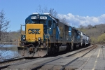 A nice standard cab duo leads Q640 (Cumberland to Selkirk) east past the station