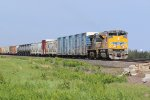 UP 8937 Brand new Up Heavy rolls west down the Triple track.