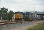 CSX 5441, 8538, and 581 heading North with a train of loaed well cars