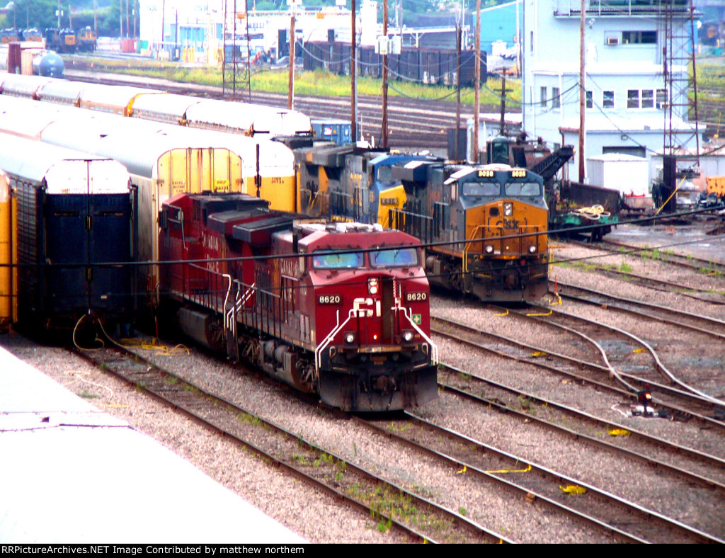 CP 8620 with another CP unit CSX 3028, CSX 636. and another CSX engine in Frontier Yard