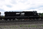 A very shiny SD60E is third out on an eastbound intermodal