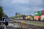 A railfan watches the action