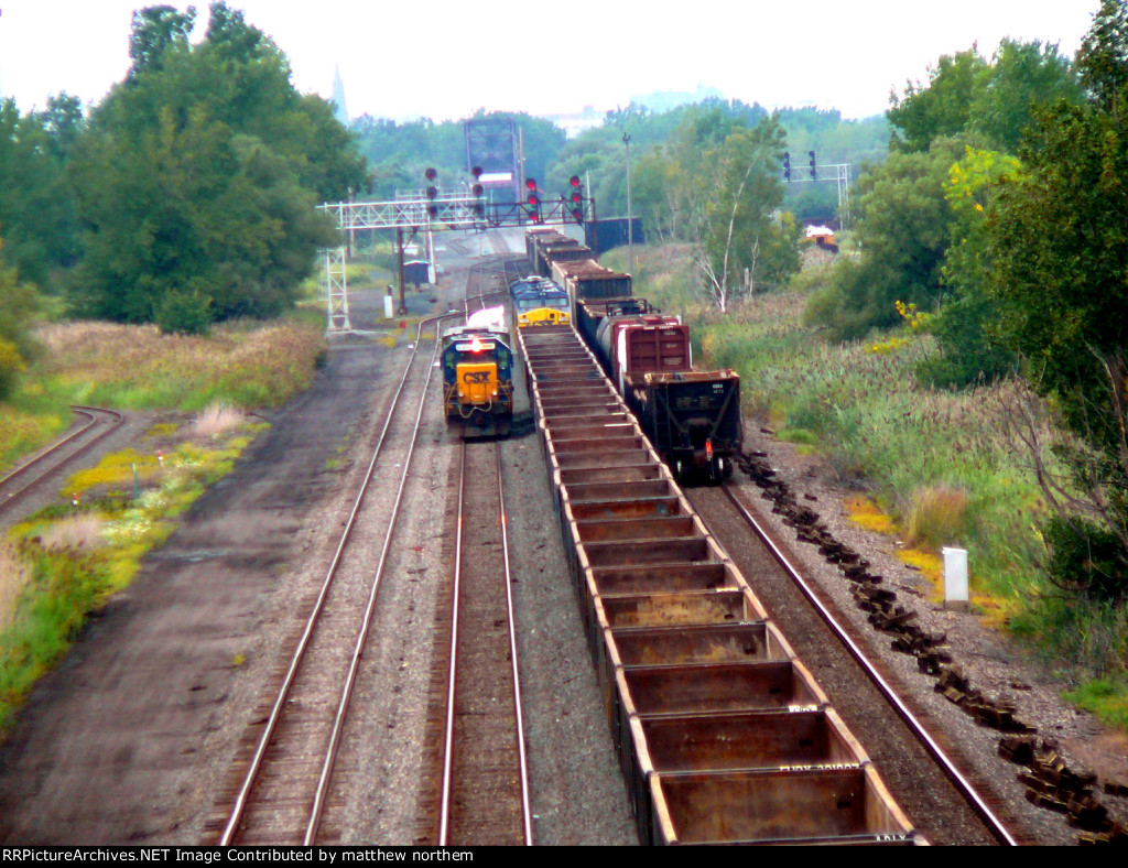 CSX 8388 witha Generator while CSX 3165, CSX 398, CSX 239, and another CSX engine stopped at signal in Tifft Yard
