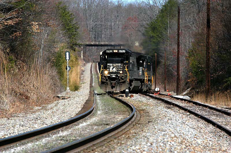 66e heads toward the end of the sliding and starts through the spring switch at the west end of the siding at clinchcross