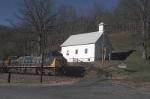 loaded coal train heads by toe river church