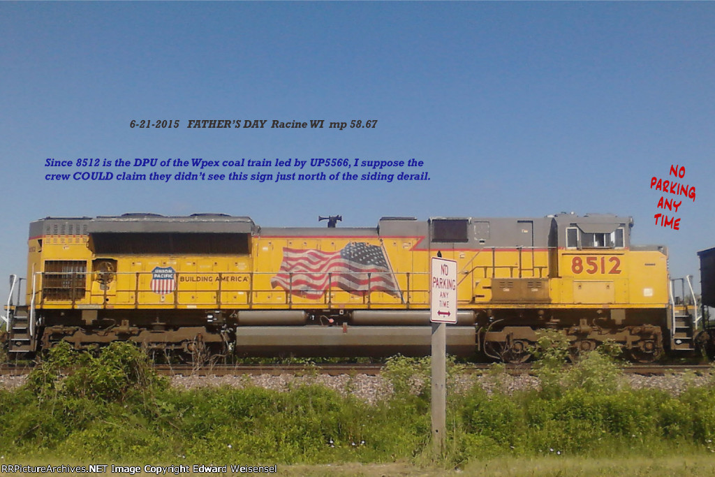 UP 8512 is parked in a peculiar place - even the railfan's avian spy knows how to read the signs
