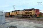 UP 7104 brings up the rear with WEPX Oak Creek coal