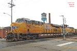 Following rail repair, Oak Creek coal rolls thru the new patch @ DeKoven Av.