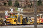 A Nordco spiker snores in the center of Muskego yard
