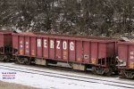About 40 empty Herzog ballast cars are hibernating