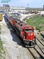 CP 4510, a MILW geep, takes a second run thru the beltline left with 20 loaded hoppers