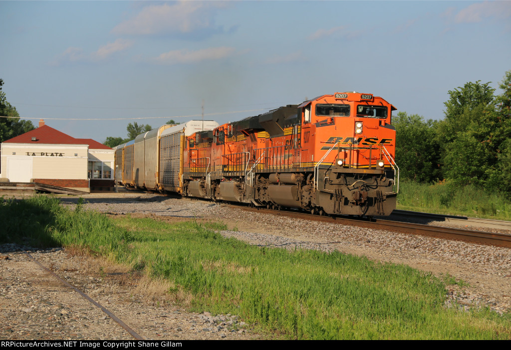 BNSF 9207 Leads a rack train west past the La Plata Station.
