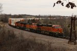 BNSF 8265 Leads a stack train down hill at Hart Mo.
