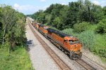BNSF 7899 Leads an all Ge stack train west down the BNSF Transcon.
